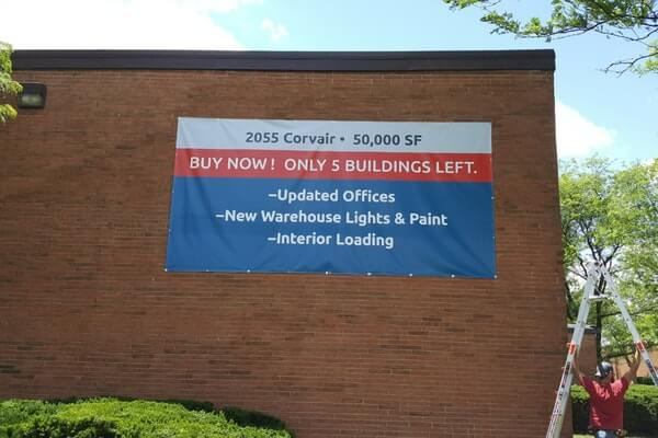 Commercial Banner Mounted to Brick