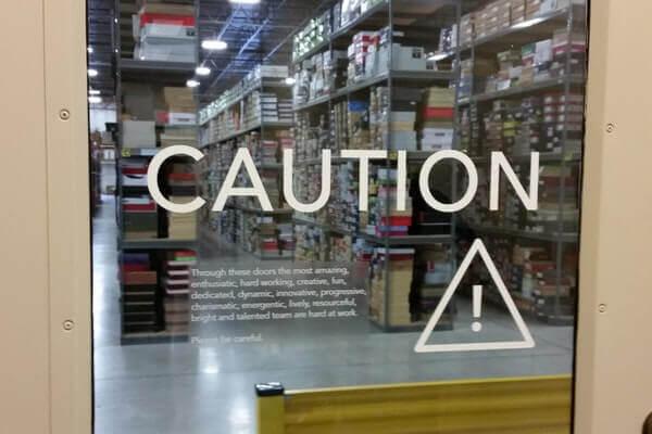 White Cut Vinyl Caution Lettering