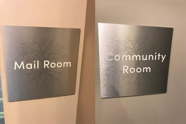 brushed aluminum signs, directly printed on with decal and white text