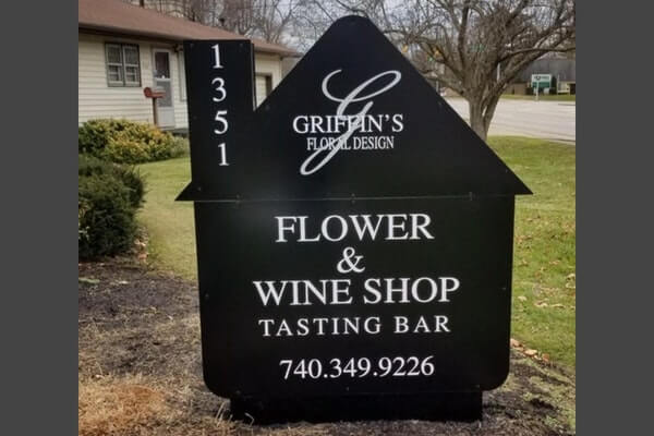 business sign with flower and wine shop signage