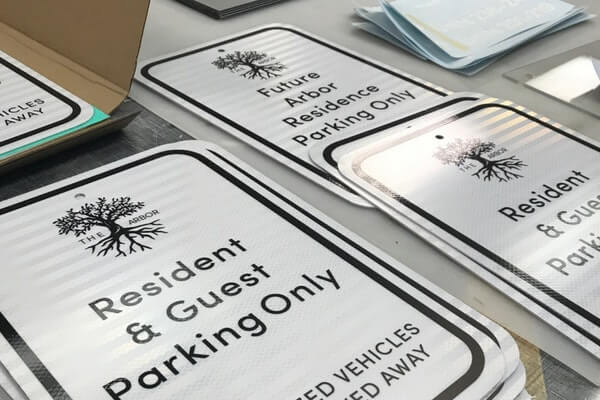 White Reflective Parking Lot Signs, Resident and Guest Parking