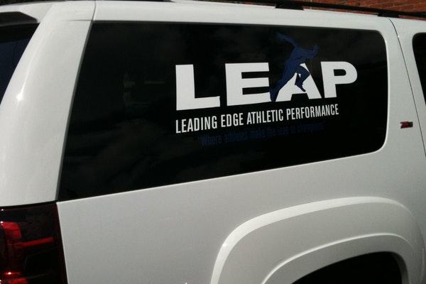 Cut Vinyl Vehicle Logo on Car Window
